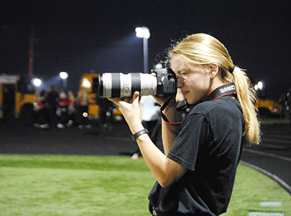 Yearbook photographers junior Julia Huebert takes photos at the BV Southwest vs. BV West football game.