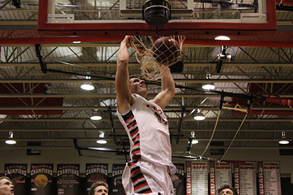 Senior Blaise Gammon shows his athletic prowess as he dunks against BV North in a winning effort on Feb. 10