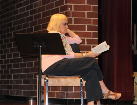 Theater director Laurie Vanderpol watches rehearsal on stage so that she can quickly interject suggestions and ideas for the experienced cast.