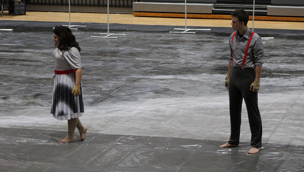 During a performance at Park Hill High School, members of Ruby Winter Guard perform to the song, Only Her Memories Remain.