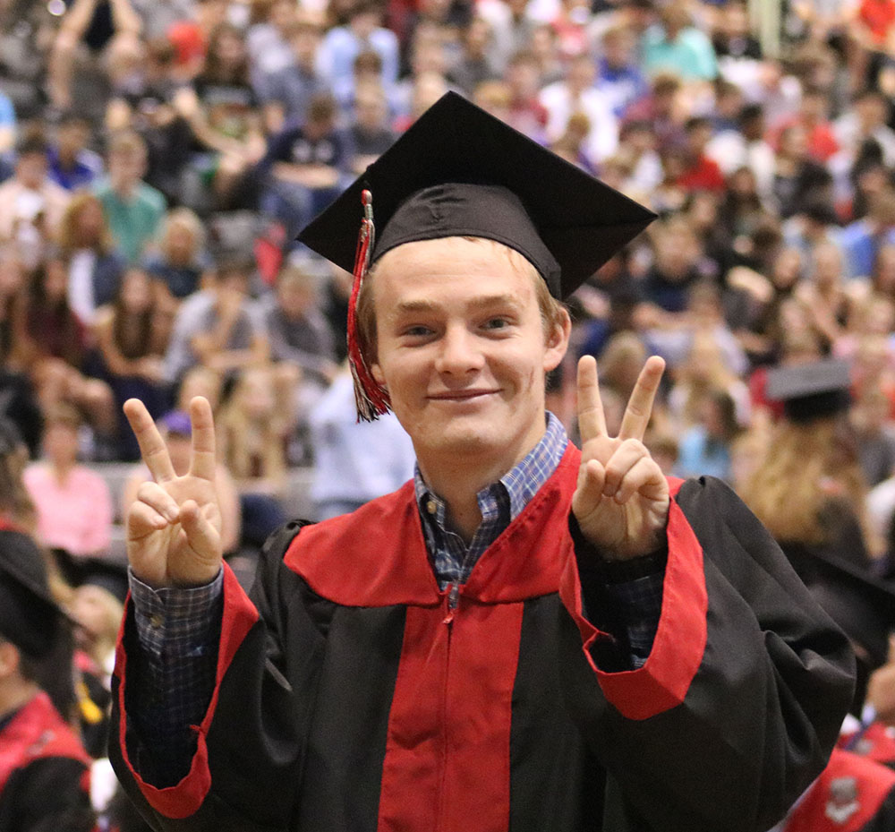 Senior+Nathan+Watkins+flashes+a+peace+sign+to+his+family+as+he+waits+in+line+to+ring+the+bell+for+the+last+time+at+BV+West.