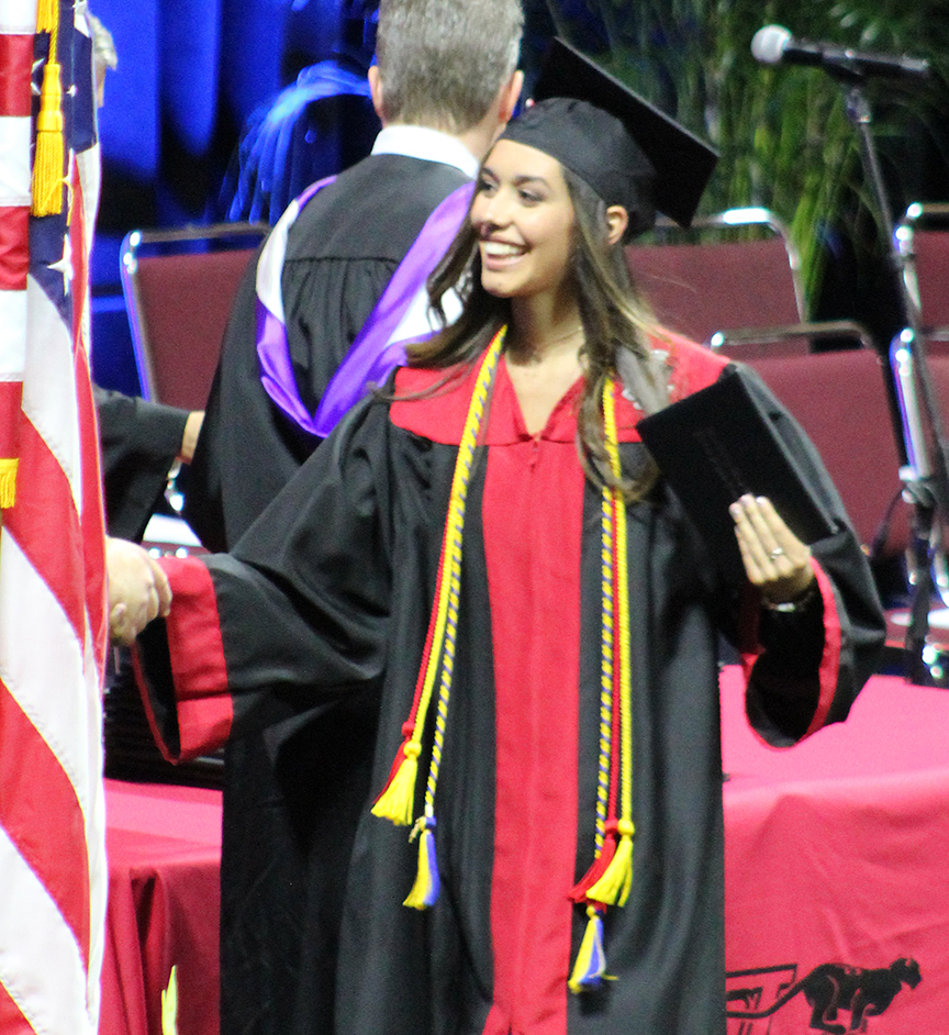 Senior+Mariana+Pulido+accepts+her+diploma+at+the+Class+of+2017+graduation+ceremony+on+May+14+at+Municipal+Auditorium+in+Kansas+City%2C+Mo.+
