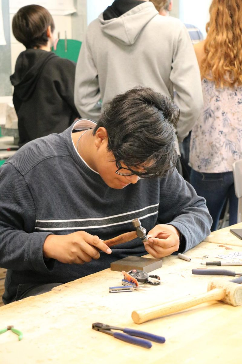 Junior+Tanner+Rupp+works+diligently+in+Jewelry+1+to+create+his+artwork.+Students+begin+with+simpler+machinery+and+work+their+way+up.