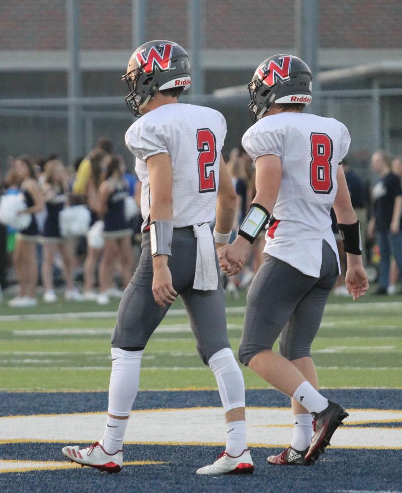 Game team captains senior Blake Goodale and junior Ben Coates walk together to meet the opposing captains from St. Thomas Aquinas on Sept. 21