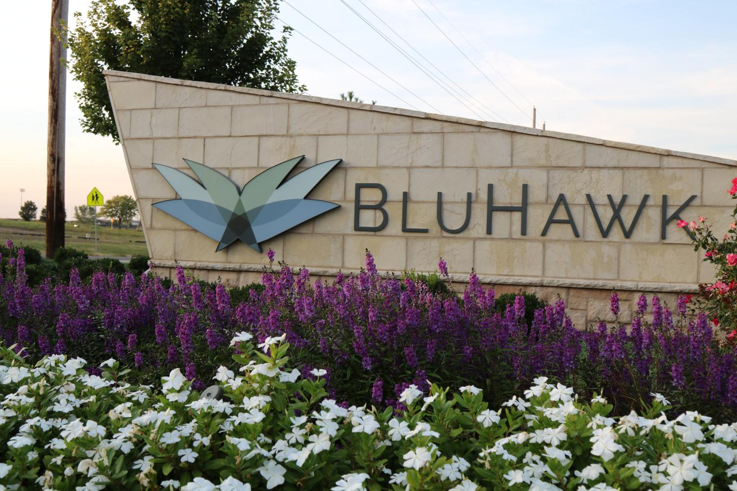 Welcome home. The entrance sign to the BluHawk neighborhood lies just east of BV West.  The  new neighborhood is part of the larger BluHawk development and has already become home to several families with students in the Blue Valley district.