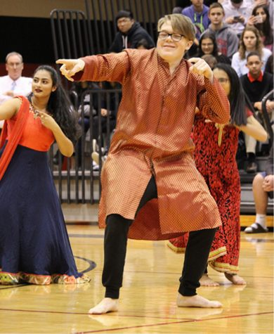 Demonstrating his personal cool vibe, even in a tunic, junior Jack Mahony performs with the Bollywood Dancers at the 2018 Diversity Assembly on Jan. 29