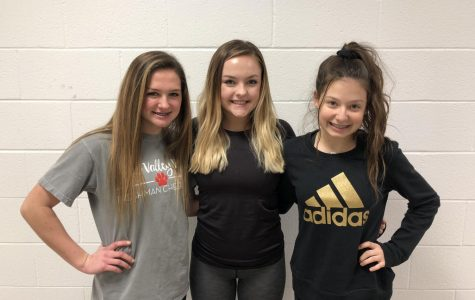 Freshman cheerleaders Cassidy Julian, AK Marquette and Umbarger pose together during a non-game day.