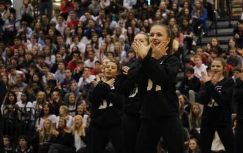 WEST SIDE. The Crimson Cats perform their routine at the assembly on 4/6.