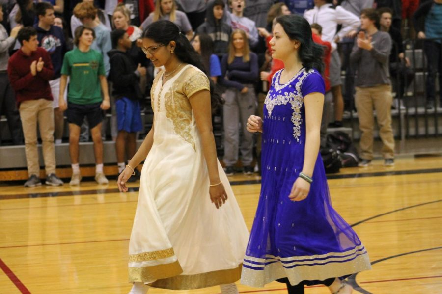 Lily Chen junior and Senior Neha Kothapalli getting ready to dance with a group infant of the school at the Diversity assembly January 26.