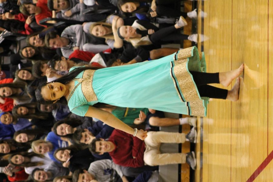 Junior, Simmi Rana stepping to the beat in a cultural dance infront of her peers at the Diversity assembly January 26.