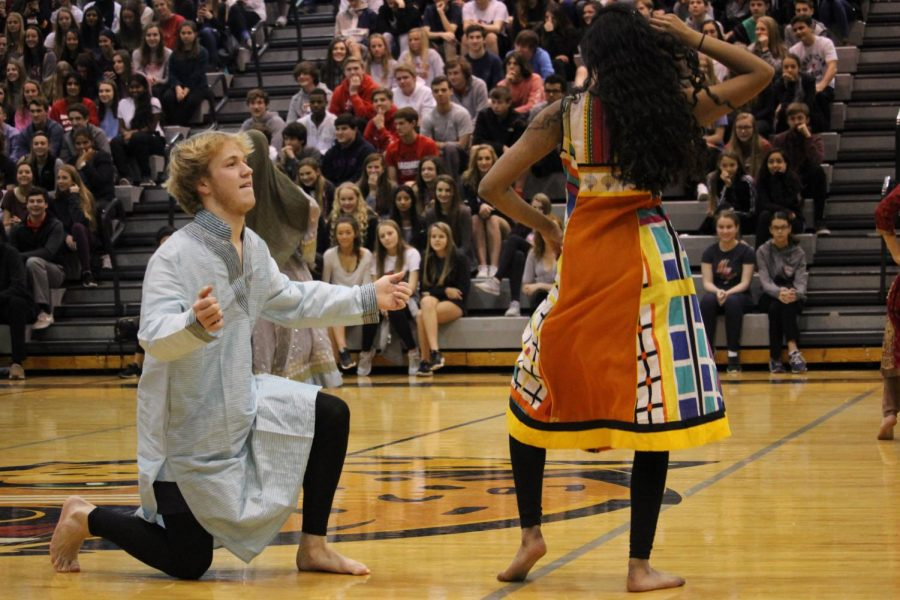 Junior, Mason McGill shaking his stuff performing along side with some amazing girls at the Diversity Assembly January 26.