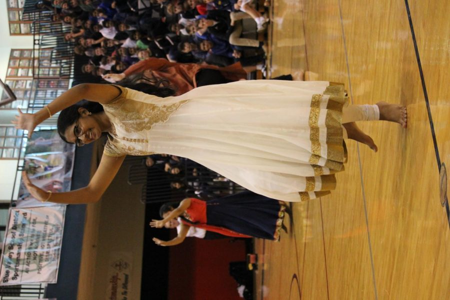Senior, Neha Kothapalli showing her jazz hands dancing along to a cultural song at the Diversity Assembly January 26.