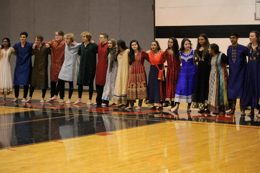 Different grades come together involved in the January 26 Blue Valley West Diversity assembly to show family and pride in one another.