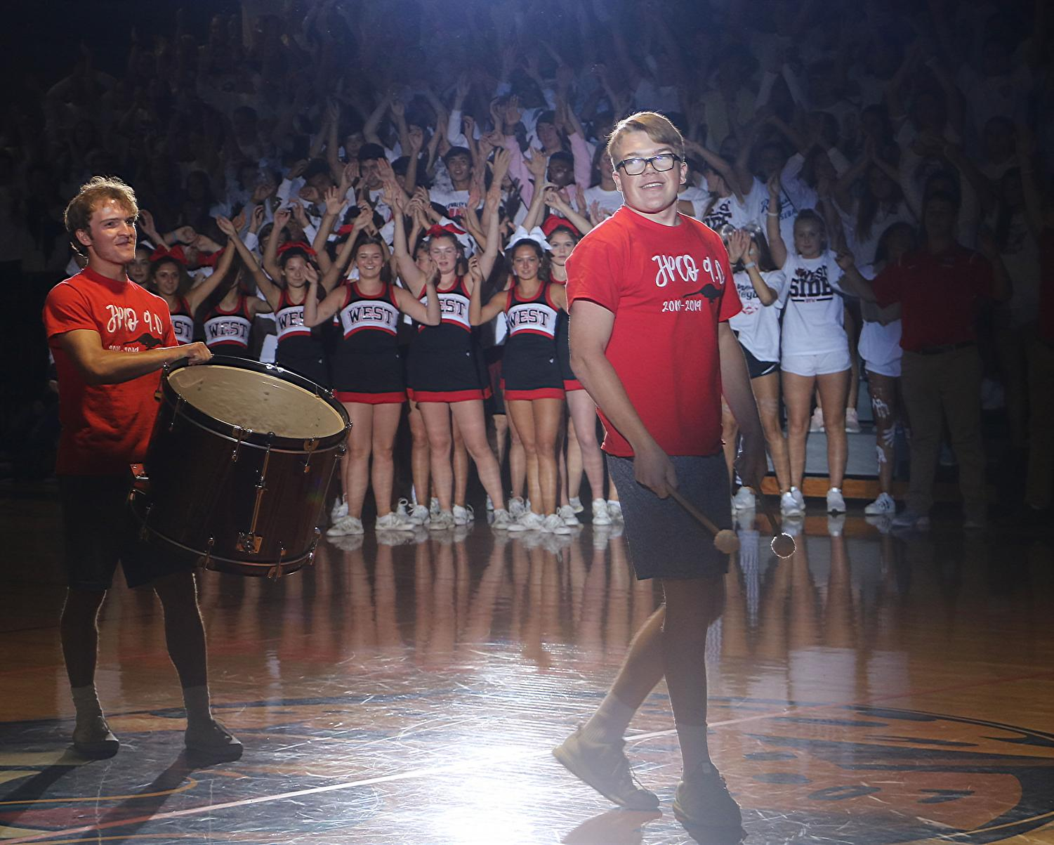 Seniors Jack Mahoney and Tommy Sulentic perform the Drum Chant an the Homecoming Assembly on Sept. 14