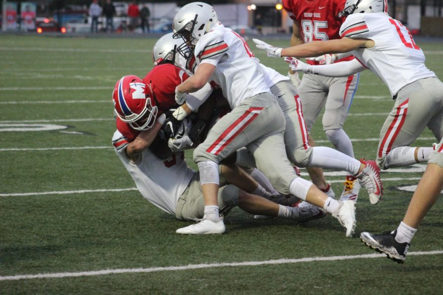 Down he goes! The boys back at making big tackles and plays to try to get that Win against Bishop Miege.