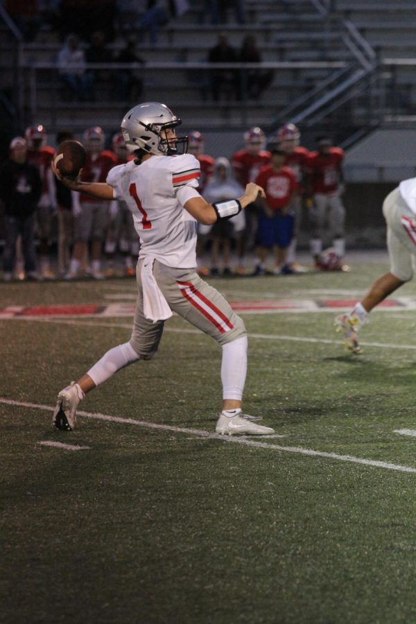 Junior Greg Riddle making an amazing throw down the field to try to score a touchdown vs Miege.