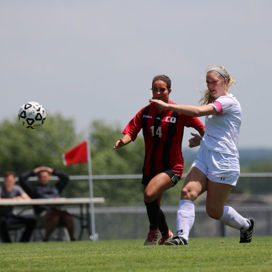Matching her skills with a SM South defender, forward Lindsi Banker gets a step on her opponent as both go for the ball in the May 22 State quarterfinal match.