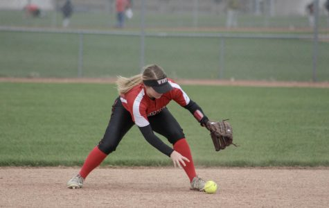 Sophomore Brenna Morrison picks up a grounder hit by BV Northwest on April 11. The Jags lost 0-1.
