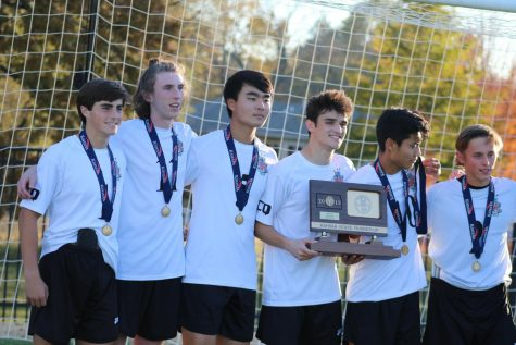 Boys soccer players show mixed emotions when accepting second place medals and trophy at State meet on Nov. 9 at Topeka