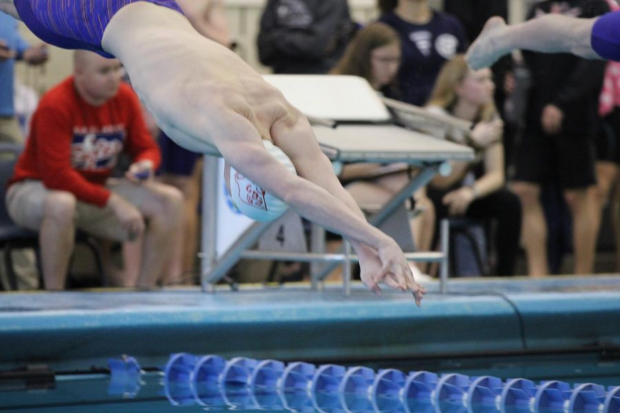 Junior Kevin Glenn shows how important it is to make a small splash when he takes to the water in the 200 IM.He made a big splash at the end of the race by winning his second state title in as many years in the event.