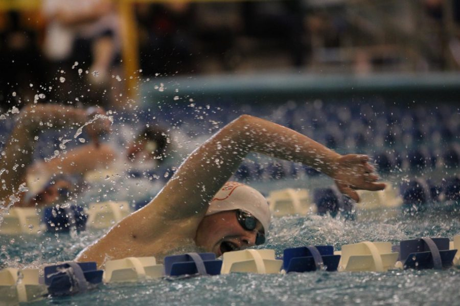 Sophomore Aidan White swims freestyle at State during prelims on Friday, Feb. 21.