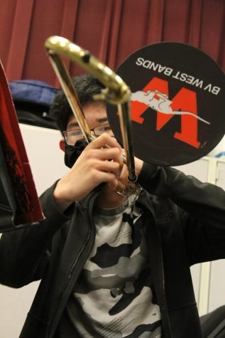 Students playing brass instruments must wear specialized masks on their faces and the end of their instruments.