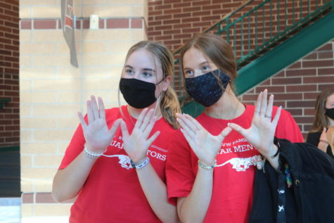 """Mentors Kaitlin Meinheit and Kiley Peterson hold up the """"W"""" for west side."""