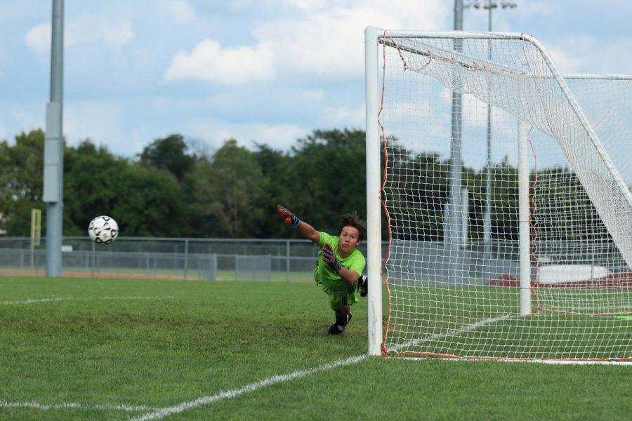 Goalie, Ryan Neil dives for the ball!