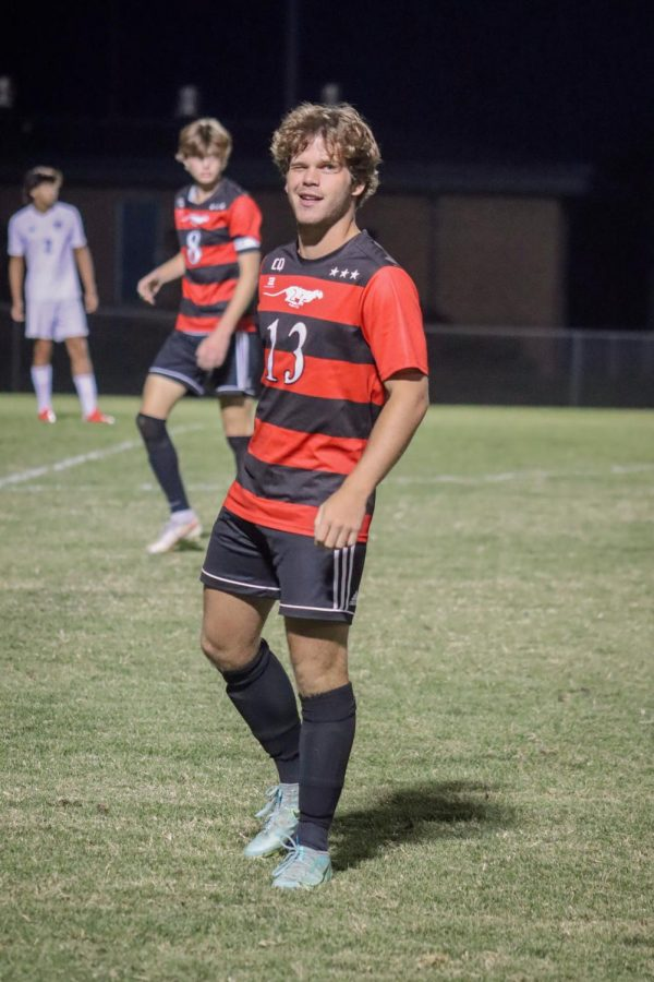 Senior Luis Masroua winks to the crowd as he subs into the game.