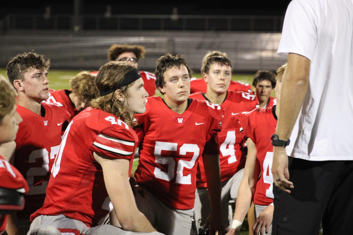 Jv football boys getting a talk after the big game.