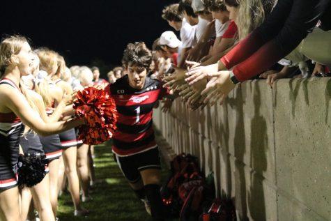 Luke Dickerson #1 (Senior) - running through fans after celebrating a 10-1 win