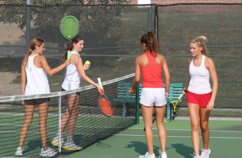 Josie Mestad and Sofia Tewell show their great sportsmanship after losing to their opponents from Shawnee Mission East High School.