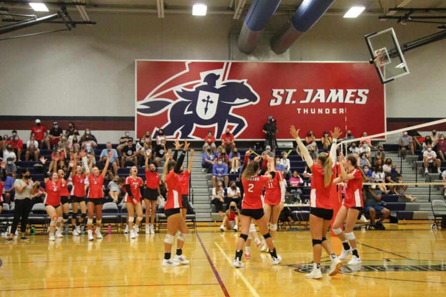 Blue Valley West Girls Varsity Volleyball celebrates a huge win against St. Teresas Academy winning both sets at the Volleyball Metro Slam on August 28, 2021.